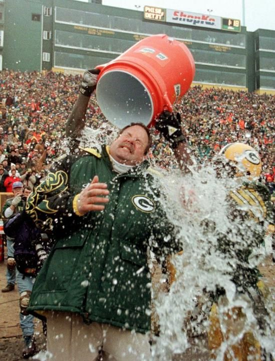 Dec. 31, 1995 - Head Coach Mike Holmgren is doused with water by players LeRoy Butler and Edgar Bennett as the final seconds tick off the clock in the NFC Wild Card game, Dec. 31, 1995, against the Falcons in Green Bay. The Packers won, 37-20, advancing to play the San Francisco 49ers in the NFC Divisional playoff