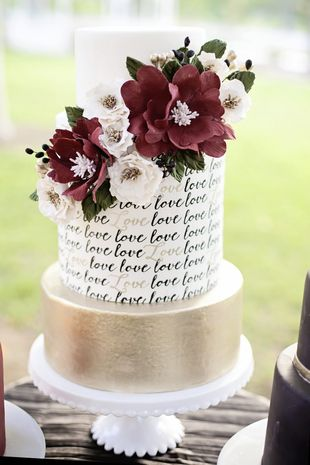 Would you add text on a wedding cake? We love the gold details and flower topper! {Nicolette Moku Photography}