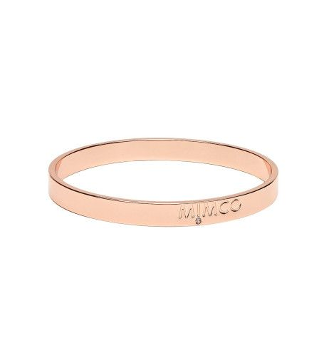 Mimco Eclipse Bangle. Mimco lends its signature branding and glass crystal detail to the Eclipse Bangle, a sophisticated, pared-down piece crafted from brass with rose gold coloured plating. Perfect for adding elegance to your wrist gallery come day or night.