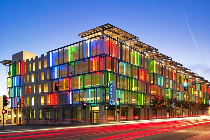 Looking for parking? Moore Ruble Yudell Architects & Planners' garage in Santa Monica, California, is easy to spot with its concrete-and-colored-channel-glass façade that appears as opaque planes of color by day and illuminated fluorescence by night.