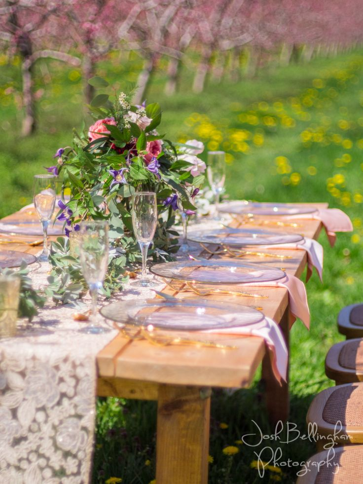 Stunning wedding reception dining table details. Wedding dinner held in a pink blossoming orchard @pambocb @niunia1977 @WarehouseNOTL @orchardcroft @constellationev #JoshBellinghamPhotography