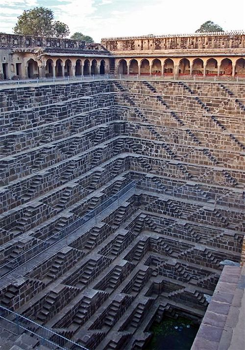 Chand Baori;  A stepwell situated in the village of Abhaneri near Jaipur in the Indian state of Rajasthan. Constructed in 800 c. and is one of the deepest and largest step wells in India.  3500 narrow steps in 13 stories and a 100 feet deep.