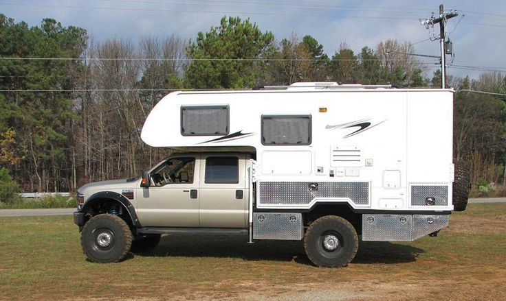 2008 Ford F550 crew cab with a Lance 830 cab over, chassis mounted camper.