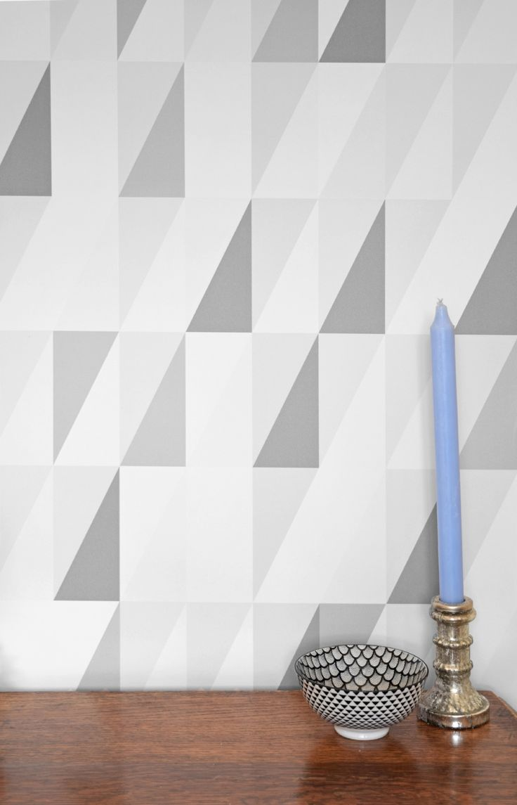 The Earl Grey Triangles wallpaper design is a playful take on the geometric collection, the absence of ...