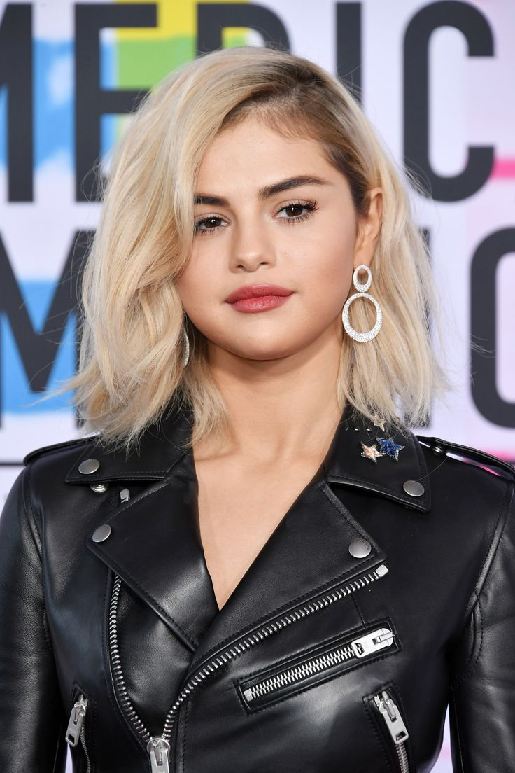Selena Gomez Just Went Full-On Blonde | Selena Gomez is now blonde! The celebrity debuted the brand new hair color at the 2017 AMAs red carpet. See an up-close look at her new look here.