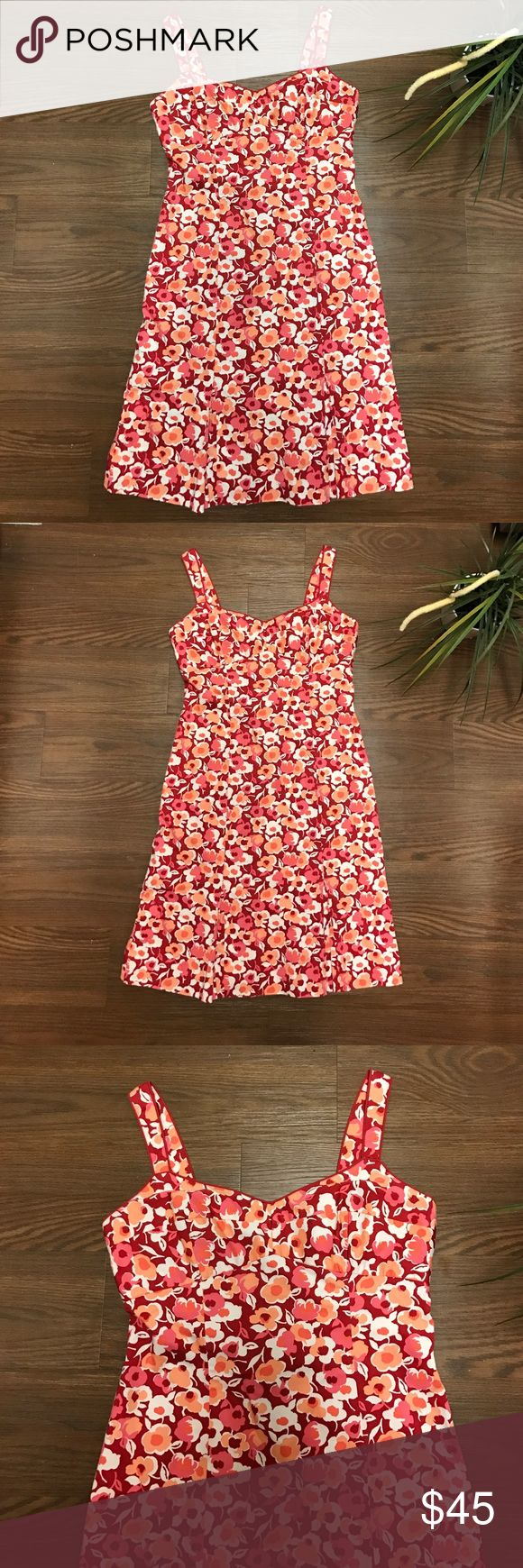 """🌼🌺Stunning Floral Dress by Ann Taylor Loft🌺🌼 This is a beautiful floral dress with defined bust area fitted down to the bottom where you where you have wonderful pleading detail. See all the photos back zipping with eyelet hook closure, bust area is lined. Colors include  maroon pink white peach etc. measurements are bust  17"""", waist 16"""", hips 17"""", and length 38"""". 96% cotton 4% spandex lining is 100% cotton Ann Taylor Dresses Midi"""