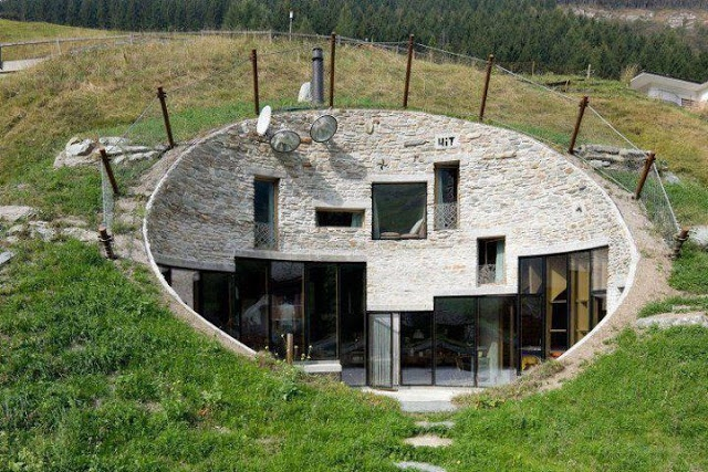 Villa Vals was originally built as a private holiday home, but now you can book a vacation for yourself in this hole in the wall, mountain wall that is, and enjoy skiing and thermal baths in the Alps while staying in this amazing house. By Architect group SeARCH and with Christian Müller Architects