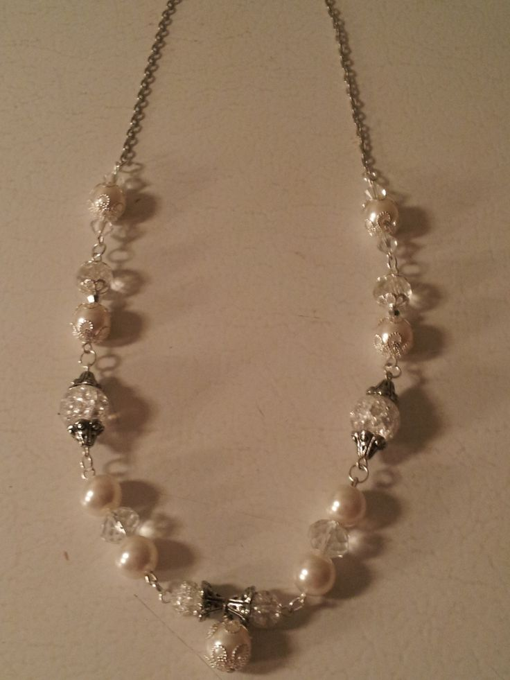 This is a winter wonder of a necklace. White, soft looking as snow, icy-looking as...well, ice.  Crackled ice to be exact.  This piece is very much on trend and would be a great addition to any jewelry collection.
