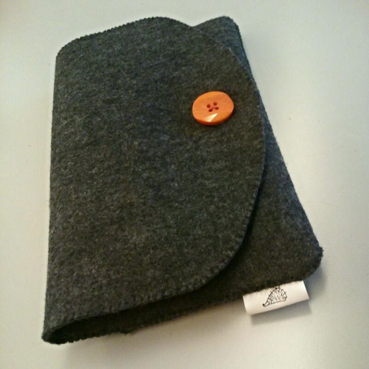 cover for tablet and accessories in felt and botton decorations