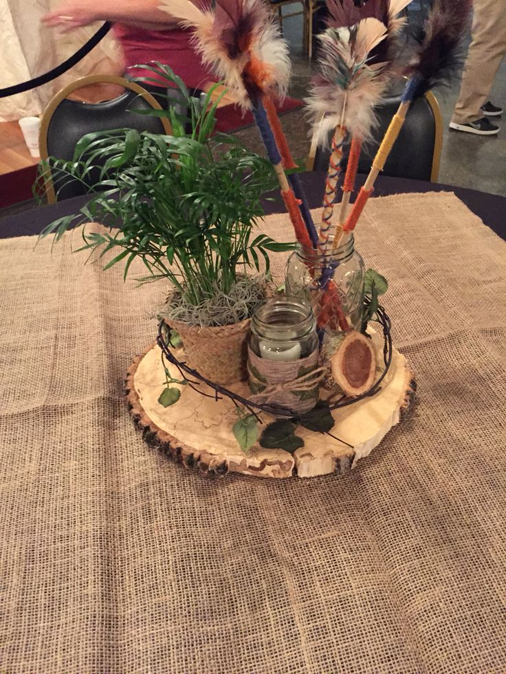'Lost Boys Hideout' table decor including hand-made arrows for 'Neverland/Peter Pan' Prom Theme!