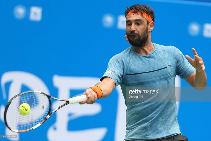 Marcos Baghdatis of Cyprus returns a shot during the match against Viktor Troicki of Serbia during Day 4 of 2016 ATP Chengdu Open at Sichuan International Tennis Centre on September 29, 2016 in Chengdu, China.