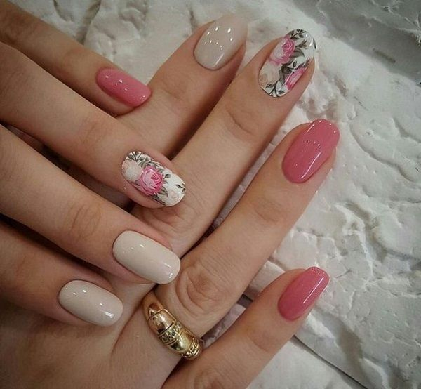 A really pretty in pink rose nail art design. The design includes very light colors of pink and the roses to show the femininity and the softness of the design.