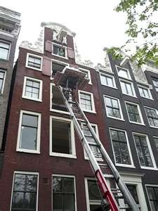 Staircases are so steep and narrow that they have to move in and out of the windows in Amsterdam.