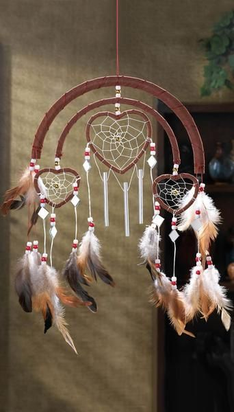 LIMITED QUANTITY SPECIAL PURCHASE! Feathers, beads and suede trim add authentic Southwestern styling to this one-of-a-kind windchime! Hang this triple-heart decoration where its sure to be admired by