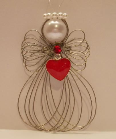 Handmade Silvertone Angel Ornament Size is approx. 2 1/2 inches w/ clear line attached for hanging