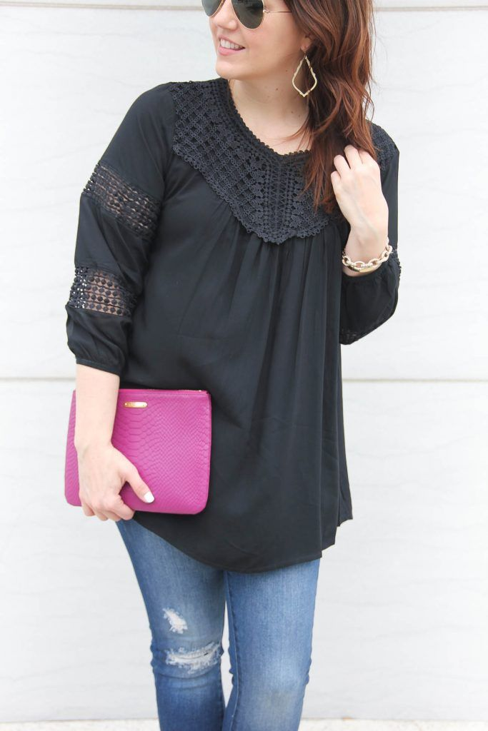 Houston style blogger styles a black crochet top to wear year round with a pink clutch.