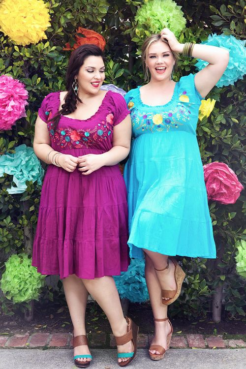 So bright and playful, let this peasant dress be the style-center of your world. An adorable, plus size gauze dress for the warmer months. Swipe a bold color over your lips and slip into your favorite wedge heels for that outdoor party coming up! Available in purple and blue!