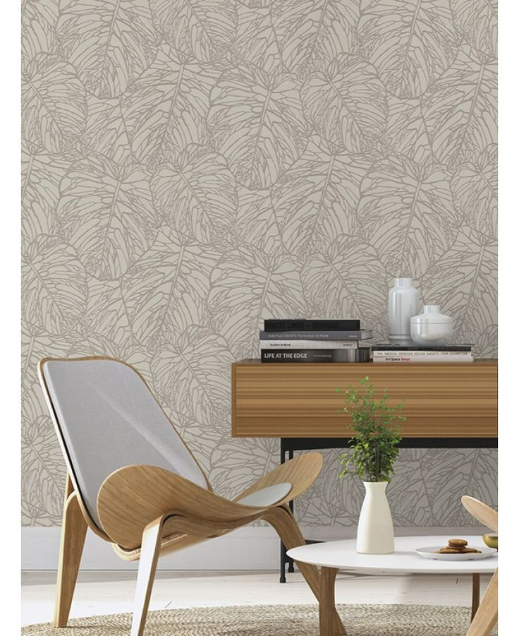 This Leaf Pattern Wallpaper in pale grey and silver features a stunning cut out metallic tropical leaf design. Free UK delivery available