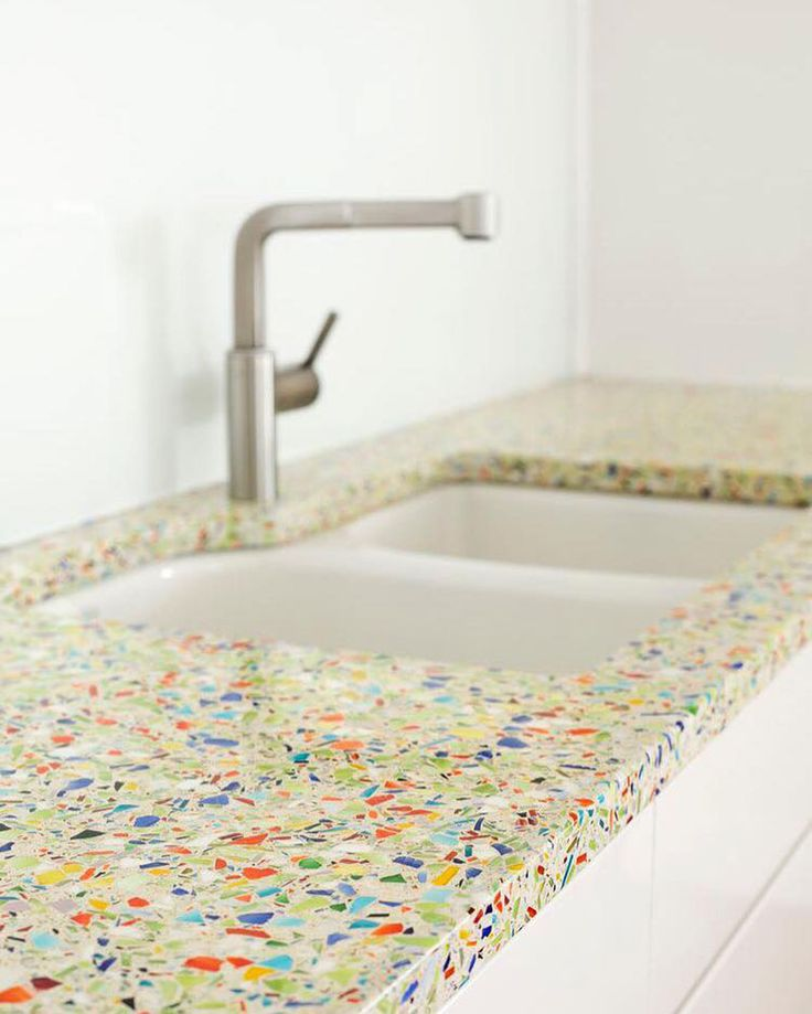 Kitchen Design Idea - 5 Unconventional Materials You Can Use For A Countertop // Recycled Glass -- Old glass materials, like bottles, windows, and beakers are crushed into tiny pieces and are either embedded into concrete or are held together with the help of a binding agent.