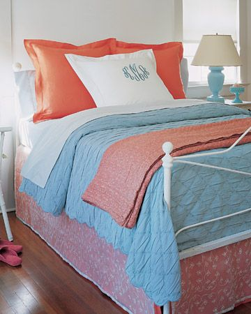 Bold Combination: coral & blue  Repeating two bright colors unifies the varied look of this bed, and the bedroom overall.