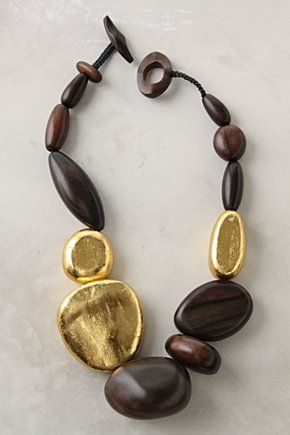 Treasure Trade Necklace at Anthropologie. Something about the mix of wood & metallic, the smooth contrast of textures, and bold shapes makes this incredibly sexy to me!