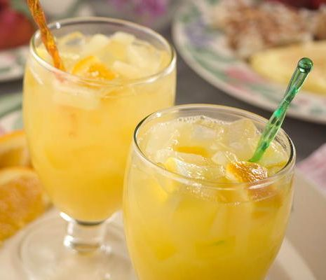 Easter Brunch Punch ~ ginger ale with a fruity blend of orange, lemon, peach, & pineapple juice ~ non-alcoholic drink recipe   via Mr. Food Test Kitchen