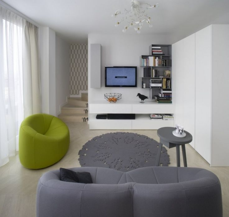 Apartment : Minimalist Krakow Apartment Designed by Morpho Studio - Krakow Apartment Living Room with Lime Green and Gray Couches and Wall Mounted Storage Shelf and White Wall Paint Color by Morpho Studio medium version