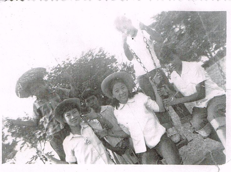 My sister and cousins . Seated in swings..left is cousin Grace Rojas (daughter of Deomedes Rojas and Sylvia Topacio).Beside her is my sis, Lita Rojas . Behind Grace is cousin Manuelita Rojas and behind Lita is Honorio (Boy) Rojas, both are children of Manuel Rojas and Placida Villanueva ( Cavite City-1950s)