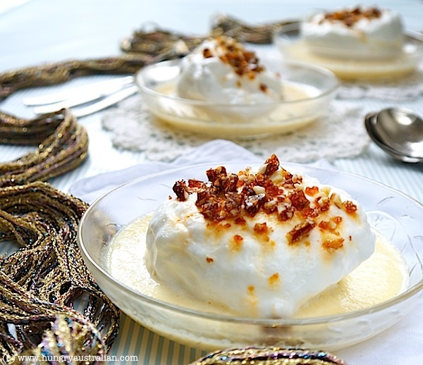 Floating Island by The Hungry Australian - poached meringue dusted with praline floats lazily on a sea of vanilla custard