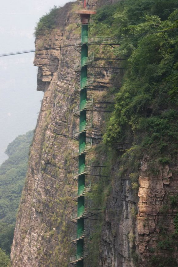 Spiral Staircase in Taihang Mountains, China.  Due to safety and health concerns, the management has qualifications before anyone is allowed to ascend. Climbers must be under 60 years of age and are asked to fill out a form confirming that they do not have heart or lung problems.