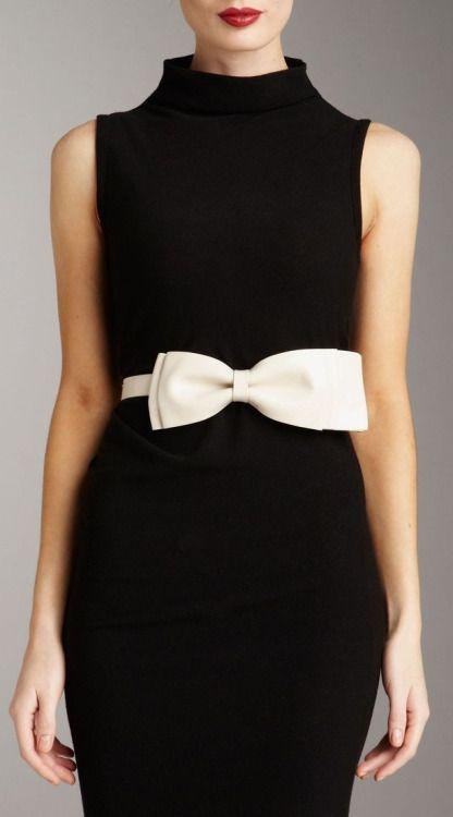 black dress, white bow.