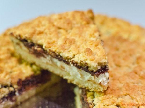 Torta sbriciolata ricotta e cioccolato. La ricetta qui ----------> http://www.petitchef.it/ricette/dessert/torta-sbriciolata-ricotta-e-cioccolato-fid-1546440
