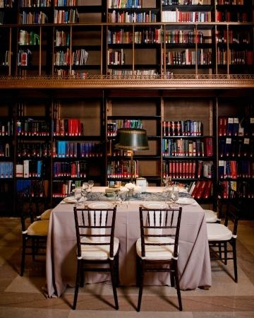 This couple used their library venue's table lamps to cast a cozy light