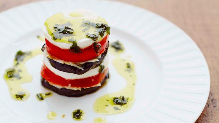 Melanzane alla parmigiana : Aubergine, tomato and mozzarella drizzled with a basil-infused olive oil