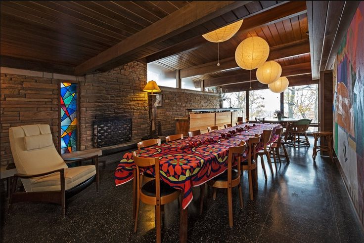 A five-bedroom midcentury modern home. Chesterfield, Mo. Designed by Ralph Fournier. The dining room has a stained-glass panel designed by Siegfried Reinhardt, an artist whose work is in the Vatican. Long room. Paper lanterns. Stone walls. Wood beams. Mini kitchen. NY Times