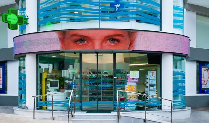 The inspiration for this innovative design of Mr.Tomaras pharmacy came from its cylindrical floor plan. The central spot catches the eye with the exhibition of the products and the impressive sculpture made of self-luminous elastic membrane which penetrates the floor and ends up to the roof.