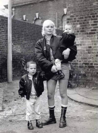 Skinhead girl with children