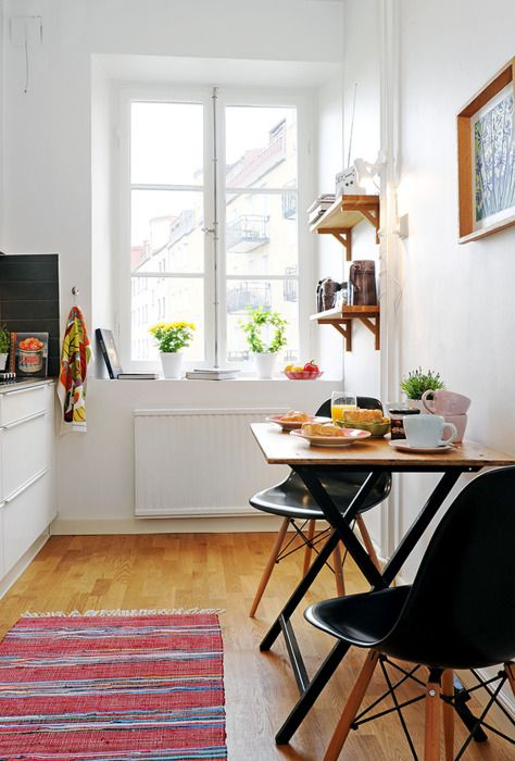 Small spaces: fabulous use of light & space in a tiny kitchen/brkfast nook...
