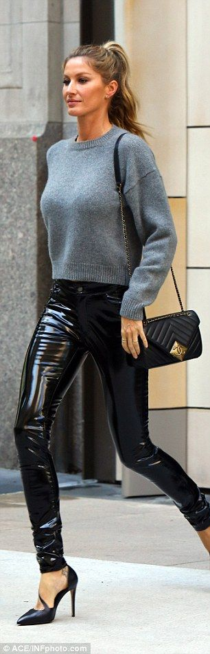Pant perfection: The model wowed in skin tight black vinyl coated pants which looked like they had been painted on to her long legs