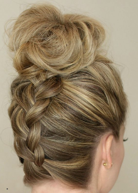 Play with the bun at the top of your head to make it look extra full with a bit of teasing. Get the tutorial at Missy Sue »  - GoodHousekeeping.com