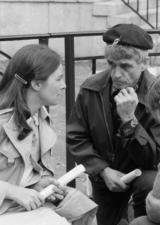 """Political activist Daniel Berrigan chats with Sister Rosaleen O'Halloran in New York on April 30, 1981, she is on a hunger strike in support of caparisoned IRA guerrilla Bobby Sands, during a rally at the United Nations in support of Sands. Sands were reported """"deteriorating at an alarming rate,"""" and his mother has promised to let him die of starvation rather than compromise. (AP Photo/Nancy Kaye) Ref #: PA.11927523  Date: 30/04/1981"""