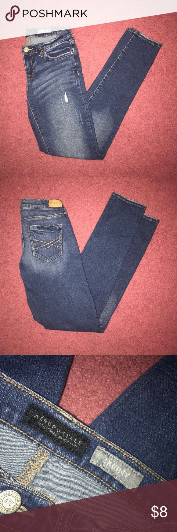 Dark Wash Distressed Skinny Jeans Aeropostale Skinny Jeans Slightly distressed, some distressing on leg openings and back pockets. Some fading on front and back (as shown). Comfortable. 75% cotton, 18% polyester, 6% rayon, 1% spandex. True to size, have a lower rise and snug fit. Super versatile, a staple item for any closet! Decent condition.  *OPEN TO OFFERS*  Size: 2 Regular  Measurements given upon request  📦 private discounts when you bundle  📫 ships the same to next day 💲 all offers…