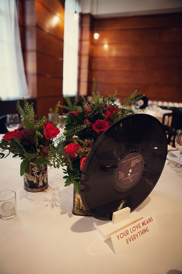Red flowers and vintage vinyl. Photography by assassynation.co.uk