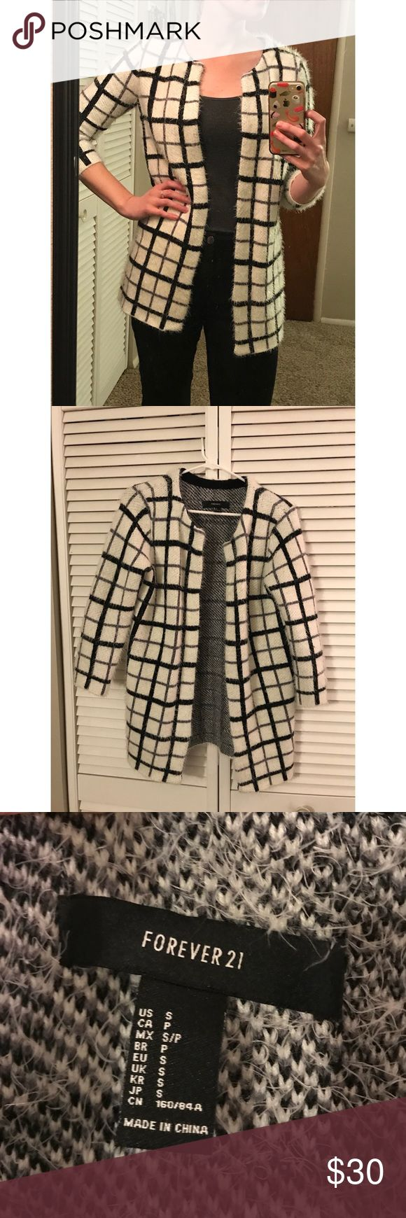Thick and cozy checkered sweater This adorable sweater is super thick and soft. Almost could be worn like a jacket. It's really great quality for Forever 21 and was only worn once. Pet free/smoke free home. Would fit a small/medium. Forever 21 Sweaters Cardigans