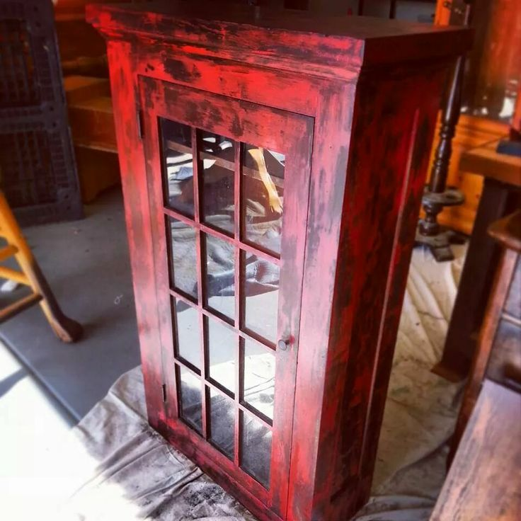 Chippy red rustic farmhouse finish cabinet