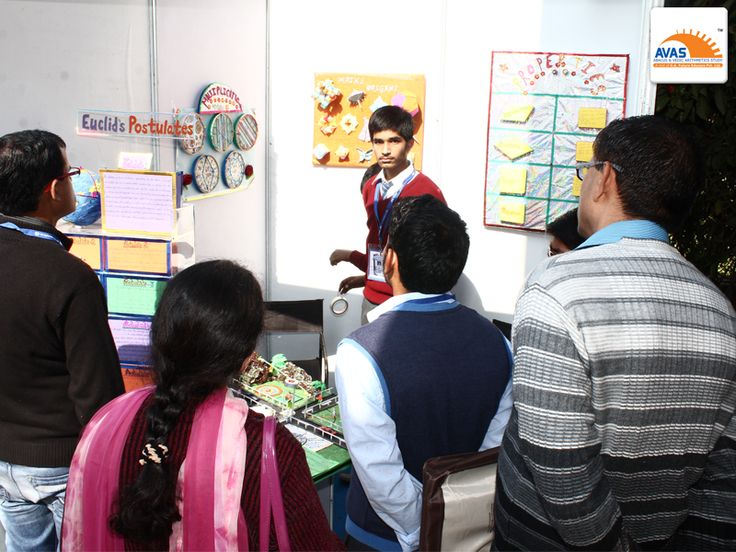 Student explaining his innovation in field of mathematics to renowned maths teachers from different schools, at IIT Delhi exhibition, organized by AVAS India