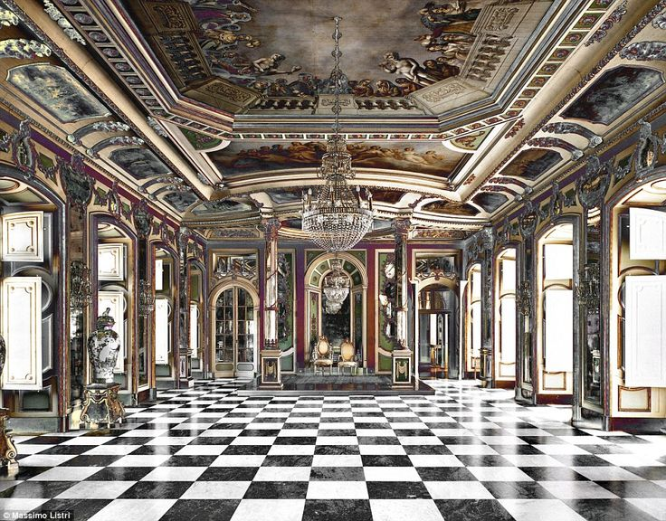 Rococo: The Queluz National Palace in Lisbon, Portugal was built in the 18th century; the grand checkered marble floors are juxtaposed against a chandelier and and painted murals on the ceiling