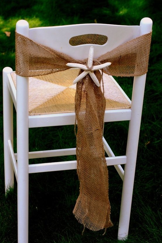 create a Beach Wedding Burlap Chair Sash with a lovely starfish to add a seaside touch! {DIY tips} Simply cut and tie a piece of burlap that is large enough to wrap around each wedding chair. Next, adorn your burlap sash with a starfish that is secured with a matching colored string or raffia.