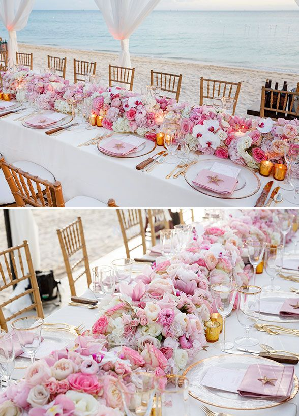 A stunning floral runner and candlelight accented the head table, while suspended twinkle lights made the entire space sparkle. Click to view the full wedding gallery: http://www.colincowieweddings.com/the-galleries/weddings-by-colin-cowie/beach-chic-bahamas-wedding#beachwedding #floralrunner #weddingcenterpiece