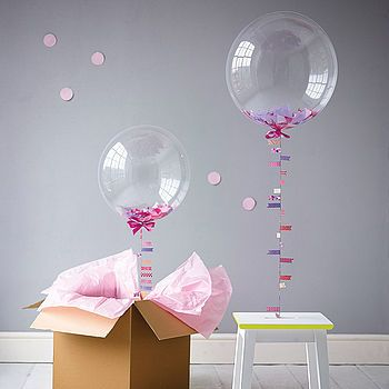 Bubblegum Balloons are filled with confetti in shades of pinks and purples and…